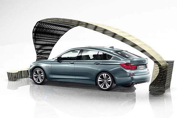 Обрамление из ротанга для рекламной инсталляции автомобиля BMW.